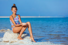 Girl with salt Dead Sea Royalty Free Stock Photo