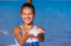 Girl with salt Dead Sea Royalty Free Stock Photography