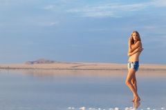 Girl in a salt lake Stock Photography