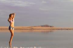Girl in a salt lake Stock Photography