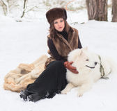 Girl with samoed dog Stock Images