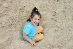 Girl in the sand. Little girl playing in the sand Royalty Free Stock Photography