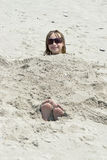 Girl in Sand Stock Images