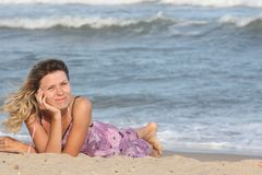 Girl  on the sand Royalty Free Stock Photos