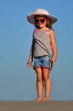Girl on the sand. Happiness Royalty Free Stock Image