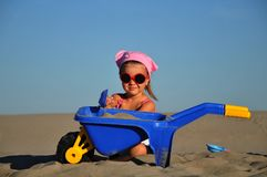 Girl on the sand. Happiness Stock Images