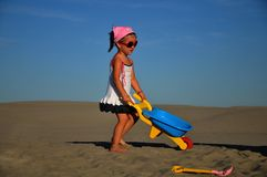 Girl on the sand. Happiness Royalty Free Stock Images