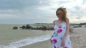 Girl on sand beach in dress. stock video