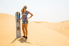 Girl sand boarding Royalty Free Stock Photos