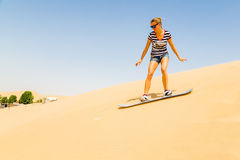 Girl sand boarding Royalty Free Stock Photo