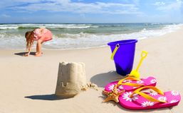 Girl by Sand Castle on Seashore Royalty Free Stock Photos