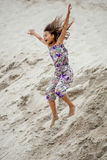 Girl in the sand Royalty Free Stock Image