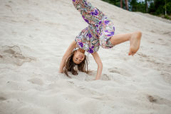 Girl in the sand Royalty Free Stock Images