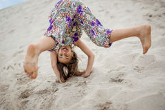 Girl in the sand Royalty Free Stock Photography