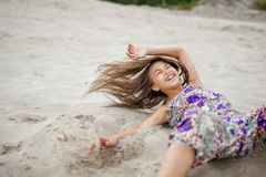 Girl in the sand Stock Images