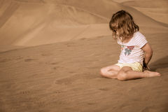Girl on the sand dunes Stock Images