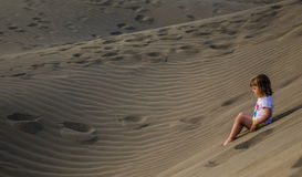 Girl on the sand dunes Royalty Free Stock Images