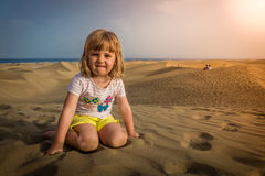 Girl on the sand dunes Royalty Free Stock Photography