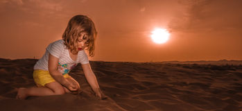 Girl on the sand dunes at sunset Royalty Free Stock Images