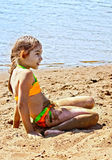 Girl on sand by the river Royalty Free Stock Photo