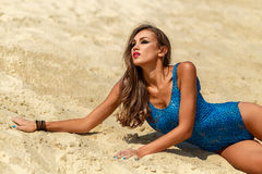 Girl on the sand Royalty Free Stock Image