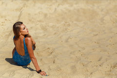 Girl on the sand Stock Image