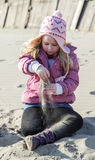 Girl in sand Royalty Free Stock Images
