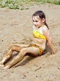 Girl on sand Stock Photo