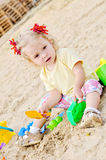 Girl in sand Royalty Free Stock Photos