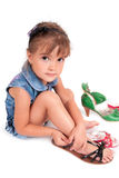 Girl with sandals Stock Images
