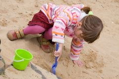 Girl in a sandbox Royalty Free Stock Photography