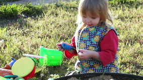 Girl in sandbox stock video footage