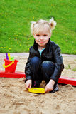 The girl in the sandbox. In the summer playing with toys Royalty Free Stock Photography