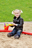 The girl in the sandbox Royalty Free Stock Photo
