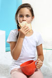 Girl with sandwich Stock Photography