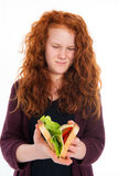 Girl with sandwich Stock Images