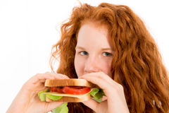 Girl with sandwich Royalty Free Stock Images