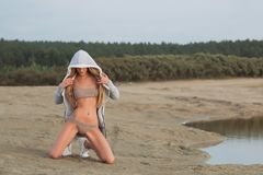 Girl on the sandy beach in a bathing suit.  Royalty Free Stock Photo