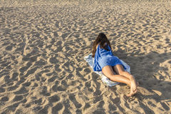Girl on a sandy beach Royalty Free Stock Photography