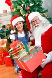 Girl with Santa Stock Photography