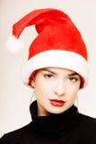 Girl in Santa cap Royalty Free Stock Image