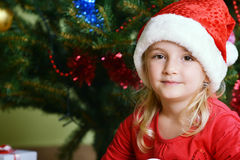 Girl  in santa cap Stock Photos
