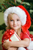 Girl  in santa cap Stock Image