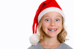 Girl with Santa- cap is grining Royalty Free Stock Images