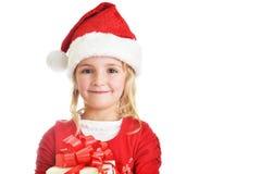 Girl in santa cap Stock Image
