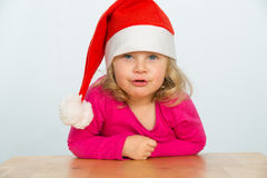 Girl with santa cap Stock Image