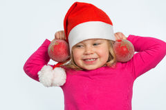 Girl with santa cap Stock Photos
