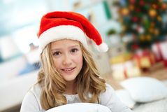 Girl in santa cap Stock Images