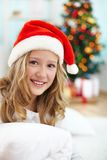 Girl in santa cap Stock Photography