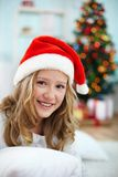 Girl in santa cap Royalty Free Stock Image